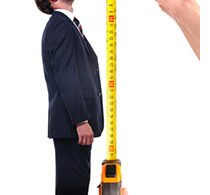 man being measured with measuring tape