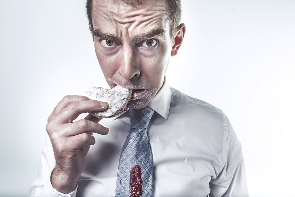 illustration of man eating a high calorie donut