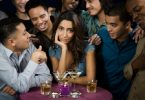 attractive woman being hit on by many men