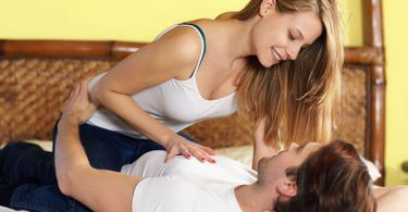 Woman On Top Of A Man In Bed