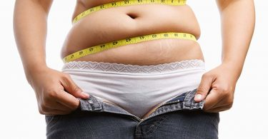 Measuring Tap Around A Woman's Belly Fat