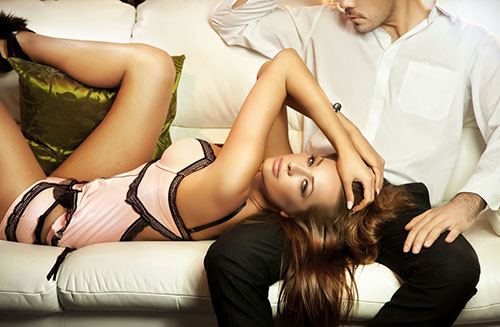 Attractive Female Laying In A Man's Lap