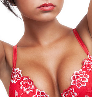 A Woman In Red Showing Cleavage