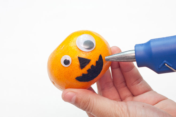 Healthy Halloween Fruit Treat - Step 4 - Glue The Mouth On