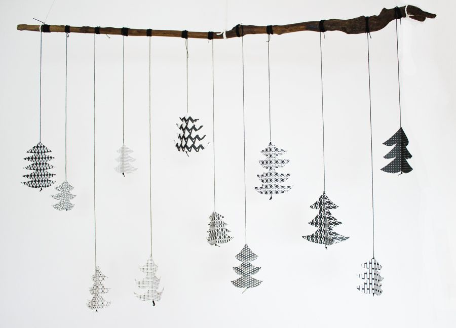 Hanging black and white 3D paper Christmas trees.