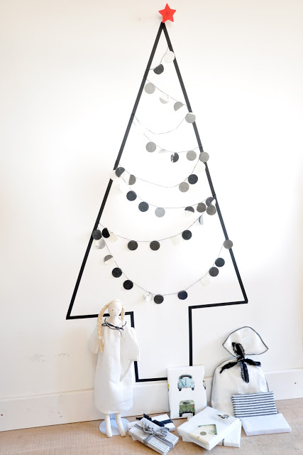 Black Christmas tree with washi tape.