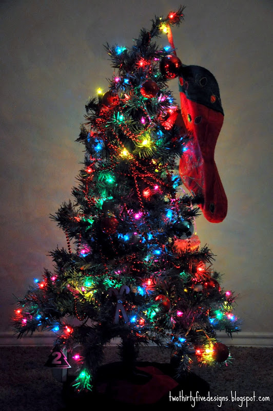 Black Christmas tree with multi-color lights.