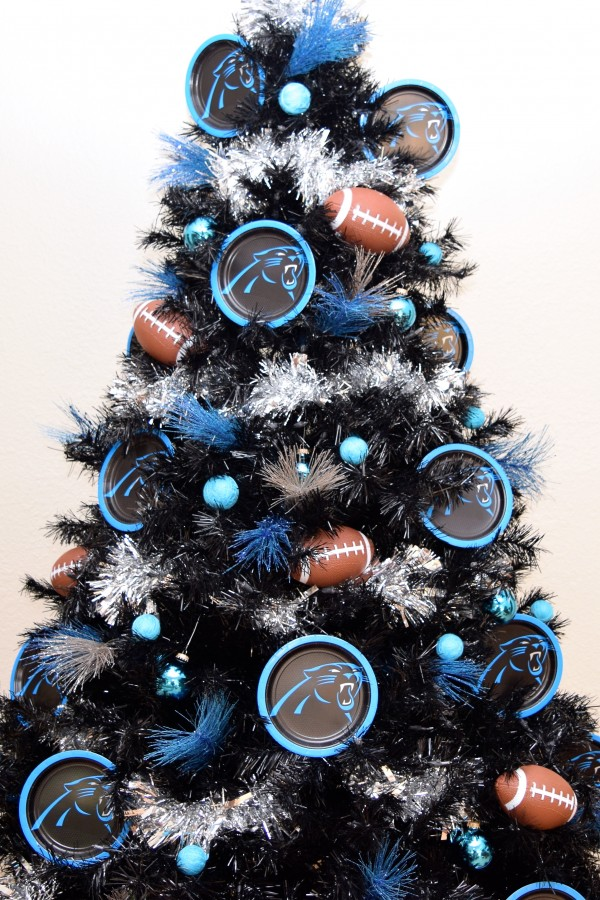 Carolina Panthers themed black Christmas tree decorating idea.