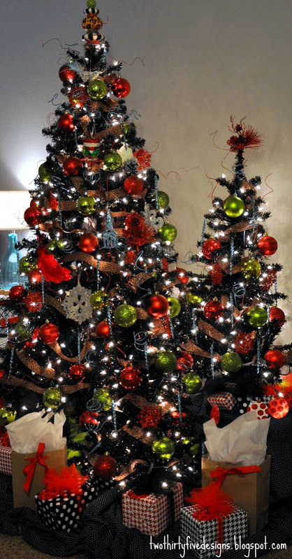Red and green decorated black Christmas trees.
